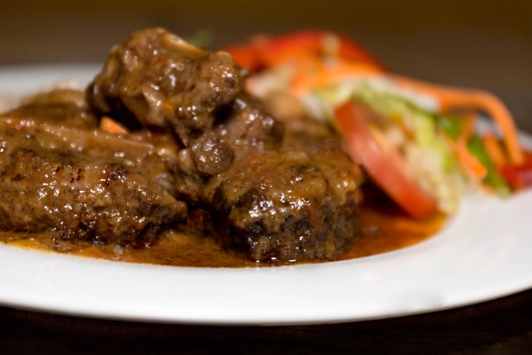 style Oxtail stew/rice and peas