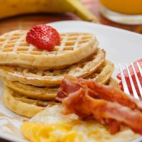 Waffles bacon and eggs breakfast